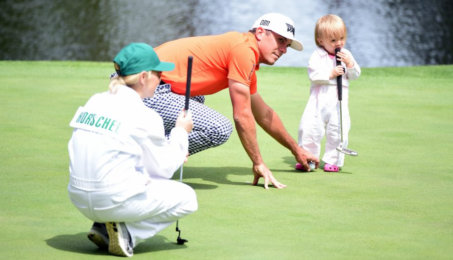Brittany and Billy Horschel with their kid at par 3 contest at Augusta
