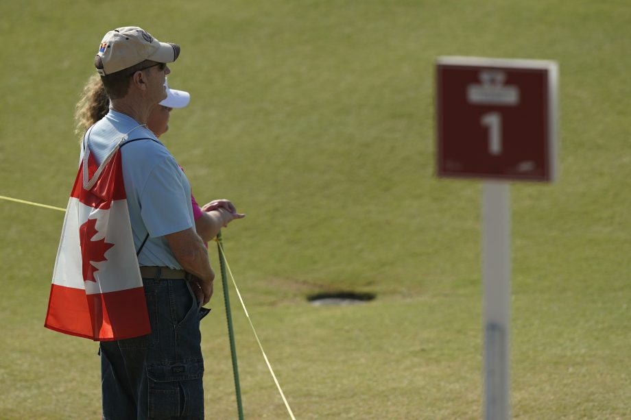 THE COLONY, TX - OCTOBER 05: A couple watches as Brooke Henderson