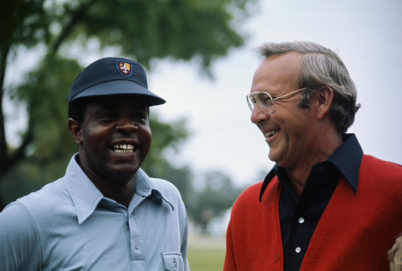 (Original Caption) New York, N.Y.: Lee Elder (L) and Arnold Palmer share a laugh during a recent tournament. Elder will be the first black to ever compete in the Masters Golf tourney. Lee elder gained his berth as the first black ever to compete in the Masters Golf Tournament by winning the Monastic Open, April 21, 1974.