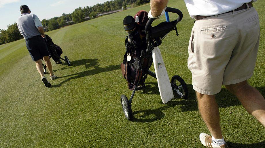 Golfers using push carts