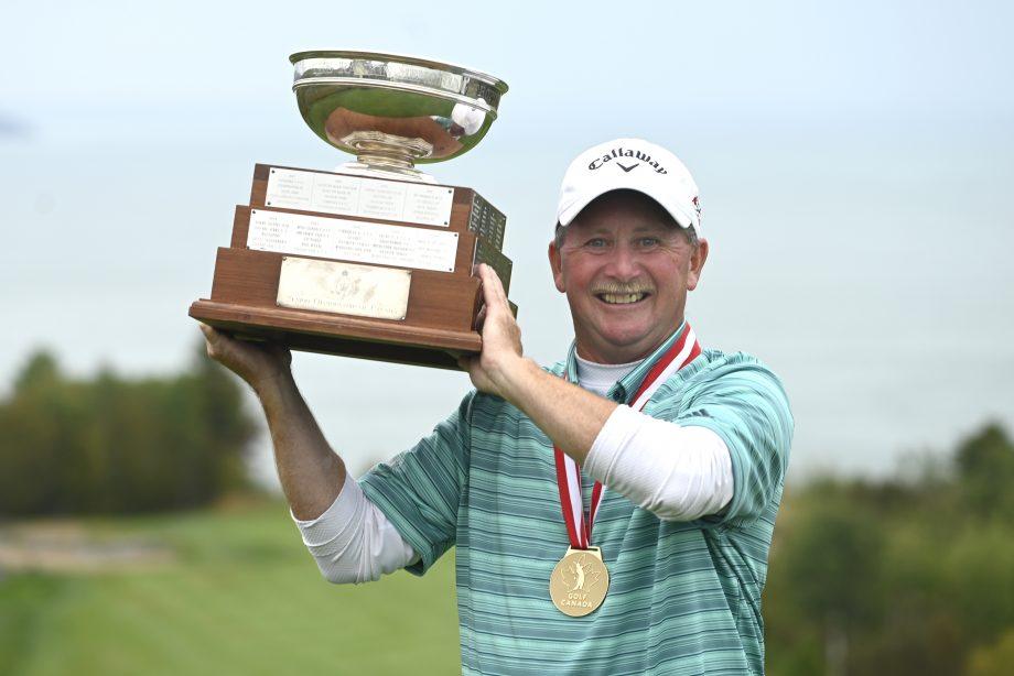 Darren Ritchie holding trophy
