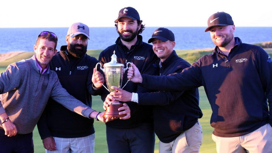 winning team of four men holding trophy